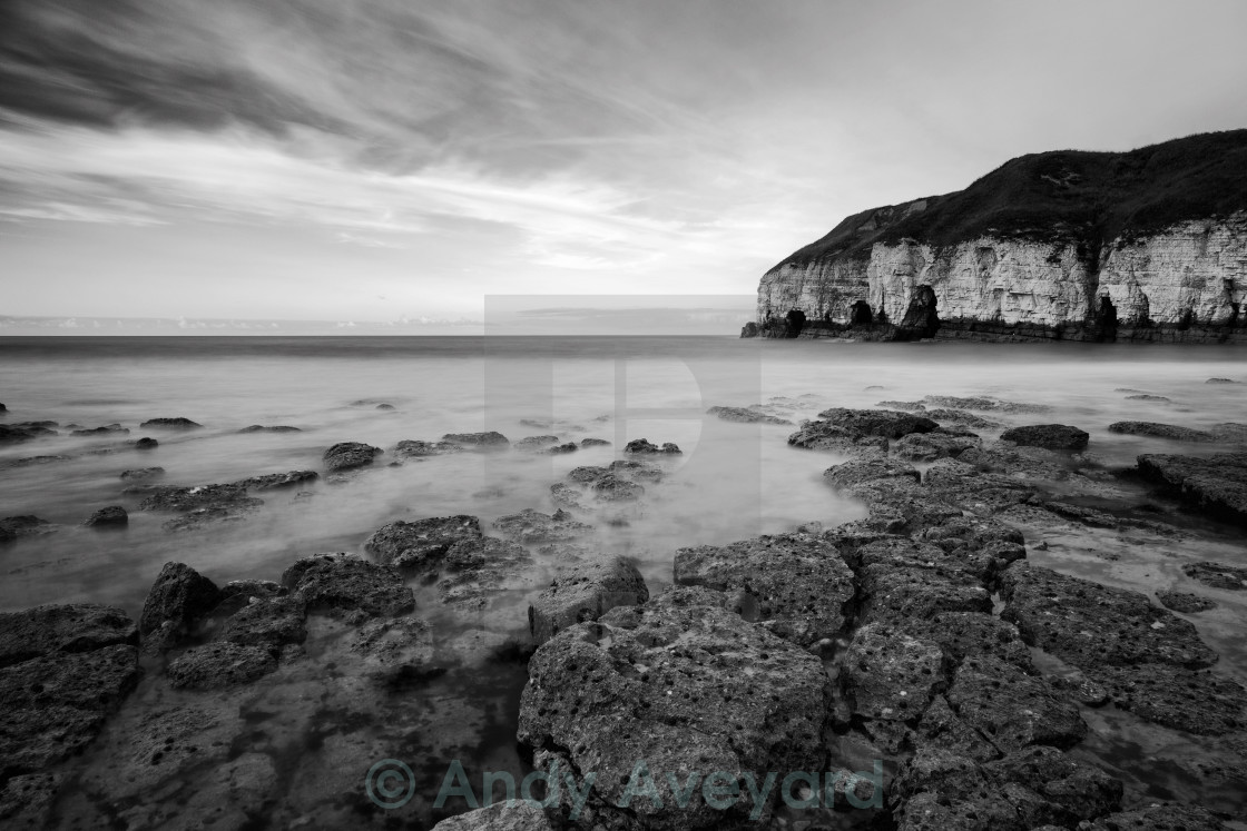"""Thornwick Bay Dark Rocks"" stock image"